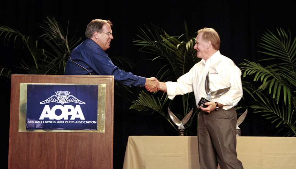 Jerry Gregoire Accepts Award from Craig Fuller